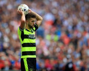 Huddersfield trio sign new deals