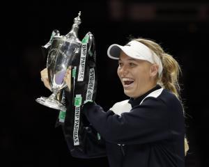 Caroline Wozniacki lands WTA Finals title in Singapore