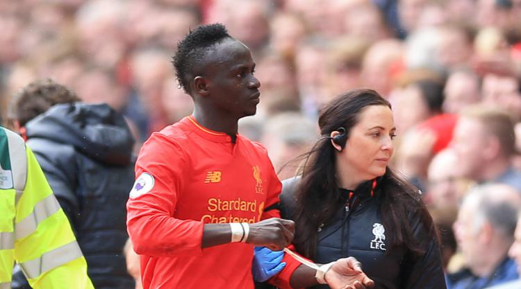 Liverpool striker Sadio Mane forced to walk with crutches after surgery