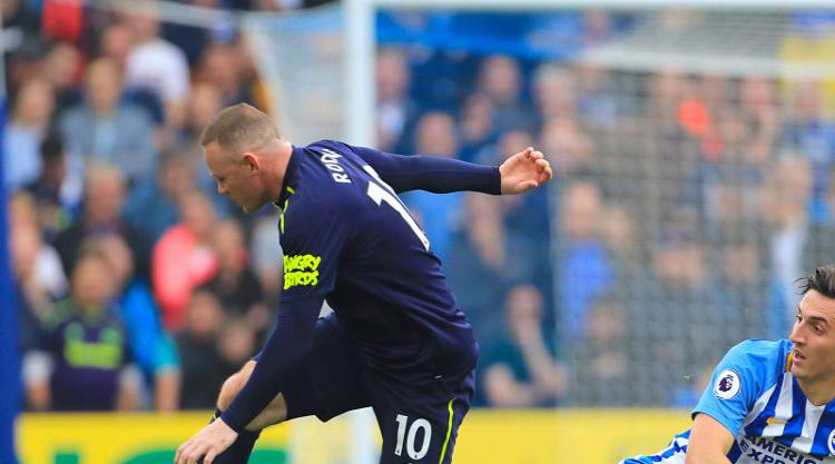 Late Rooney penalty salvages point for Everton at Brighton