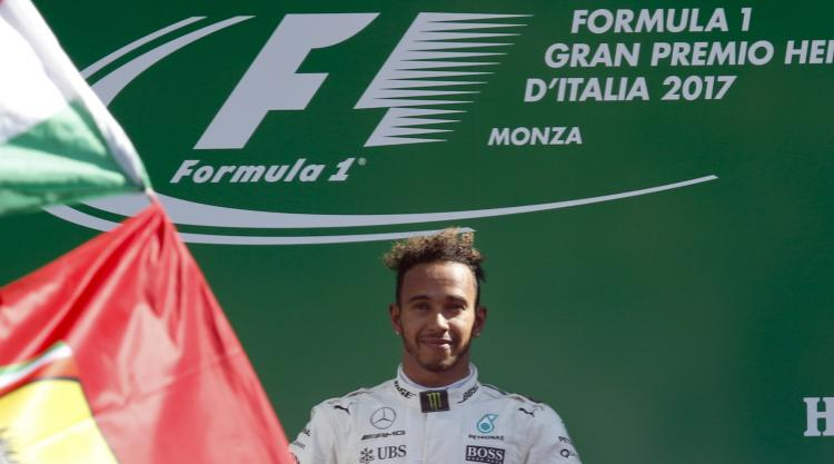 Lewis Hamilton takes title lead with easy Monza win