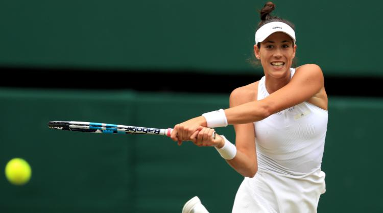 Muguruza moves into Wimbledon semi-finals